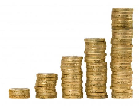 Pound coins in piles